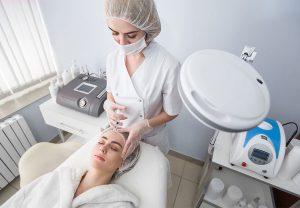 women getting facial procedure
